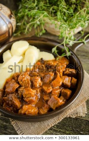 Varkensvlees tomatensaus aardappel vlees geserveerd plaat Stockfoto © Digifoodstock