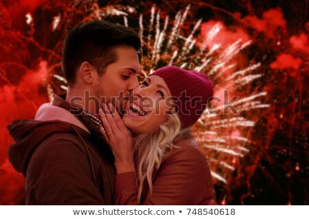 people kissing in the fireworks stock photo © adrenalina