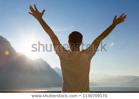 Tourist standing with raised arms up. Stock photo © RAStudio