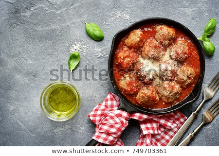 Chicken meatballs with rice braised in vegetables  Stock photo © yelenayemchuk