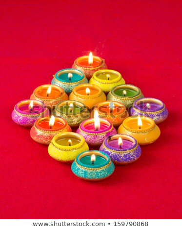 Stock photo: vibrant colorful diya for diwali background