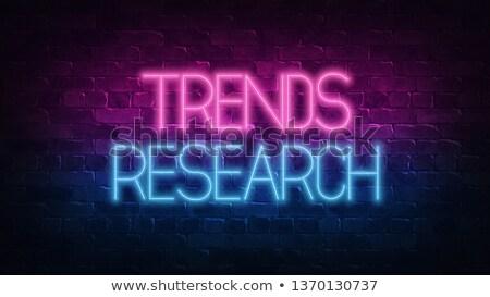 marketing research on dark brick wall stock photo © tashatuvango