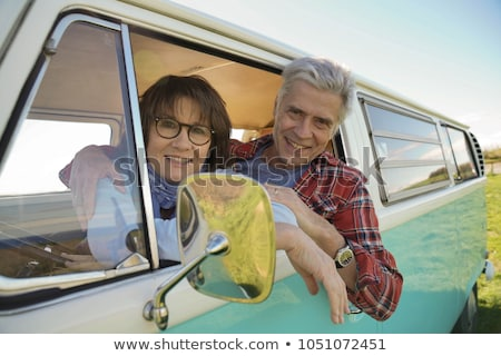 Mature couple with vintage camper van Stock photo © IS2