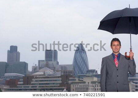 Mann with umbrella city scape Stock photo © IS2
