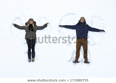 Young couple lying in snow Stock photo © IS2