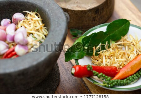 mortar and pestle with herbs and spices stock photo © shutter5