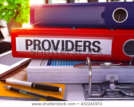 Stock photo: Providers on Red Ring Binder. Blurred, Toned Image.