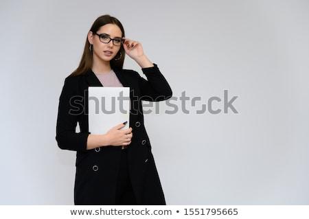Gyönyörű iskolás lány üzlet öltöny okostelefon kéz Stock fotó © Traimak