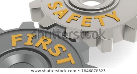 Industrial Security on Golden Cogwheels. 3D Render. Stock photo © tashatuvango