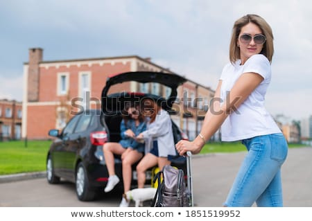 three women with suitcases on the road stock photo © is2