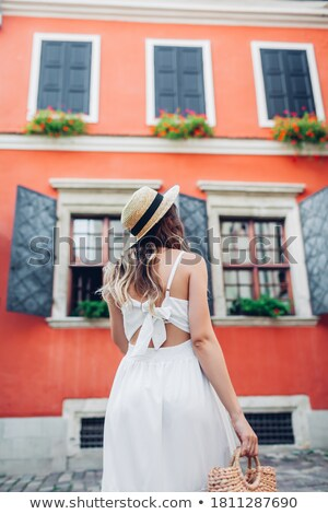 back view of elegant woman wearing a backless black dress Stock photo © feedough