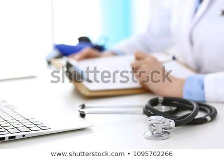 doctor filling up medical form stock photo © lana_m