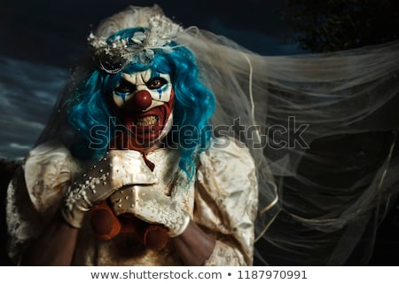 evil clown in bride dress strangling a teddy bear Stock photo © nito