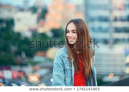 Portré fiatal lezser lány másfelé néz izolált Stock fotó © deandrobot