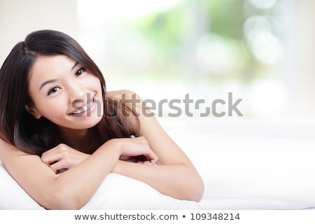 happy asian young dreaming woman face at home Stock photo © dolgachov