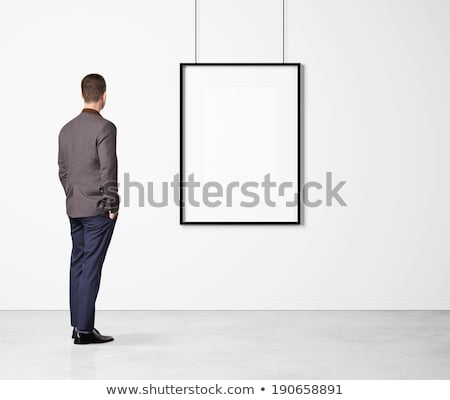 businessman looking at the picture frame stock photo © elnur