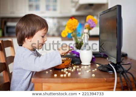 Little boy having cereal with milk Stock photo © colematt