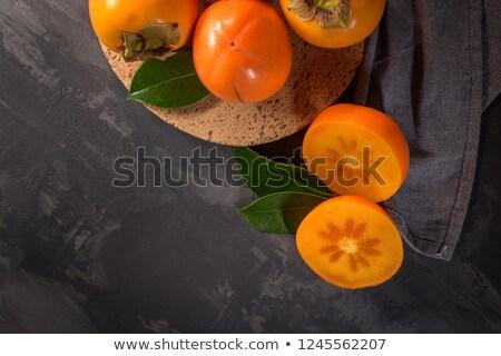 柿 果物 コルク プレート 暗い ストックフォト © homydesign