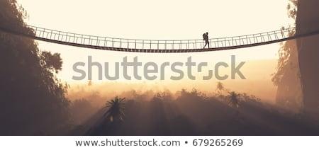 Stock photo: Wooden bridge with rope