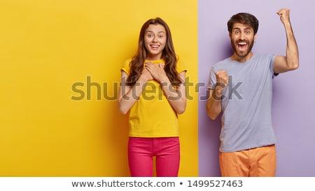 genç · bakıyor · kâğıt · gülme · işaret · gülümseme - stok fotoğraf © kurhan