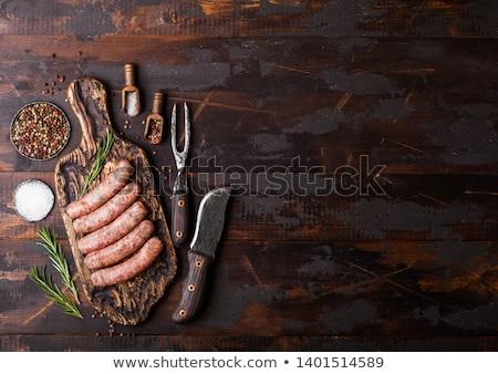Brut boeuf porc saucisse vieux planche à découper Photo stock © DenisMArt