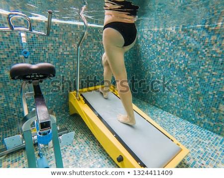 Young woman jogging on an underwater treadmill Stockfoto © galitskaya