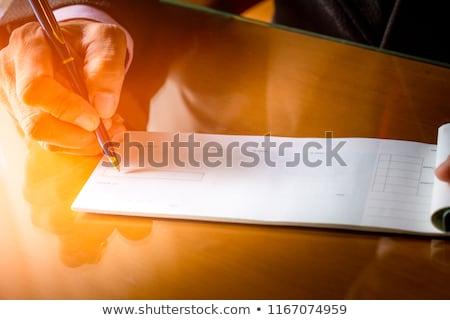 közelkép · csekk · közelkép · könyv · fókusz · illetmény - stock fotó © hfng