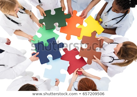 high angle view of medical team solving jigsaw puzzle stock photo © andreypopov