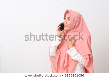 Happy young muslim female with smartphone phoning someone Stock photo © pressmaster