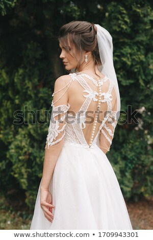 Young brunette bride with flowers in loft  Stock photo © dariazu