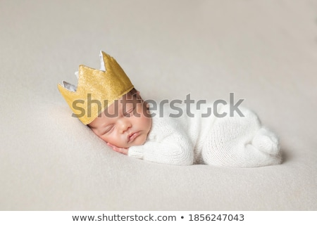 baby boy with yellow blanket on head stock photo © lichtmeister