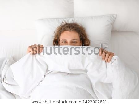 Homem travesseiro cara adormecido quarto casa Foto stock © wavebreak_media