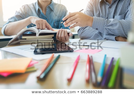 tutor books with friends young students campus or classmates he stock photo © freedomz