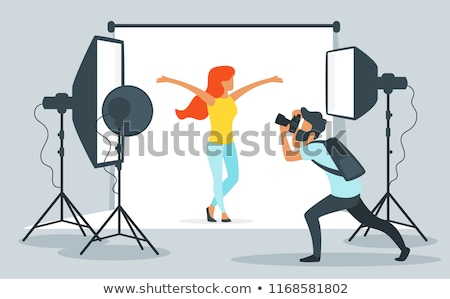 Silhouette Of A Girl Photographer Working In The Studio Foto d'archivio © curiosity