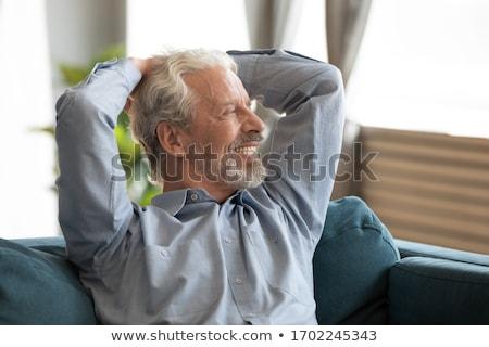 Supérieurs homme détente salon Photo stock © wavebreak_media
