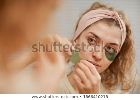 Woman Applying Patch On Her Body Stock photo © AndreyPopov