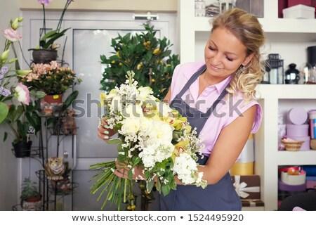 Kwiaciarz sprzedawca biały lilie kwiaciarnia małych firm Zdjęcia stock © dolgachov