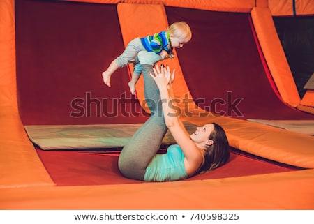Mãe filho saltando trampolim fitness parque Foto stock © galitskaya