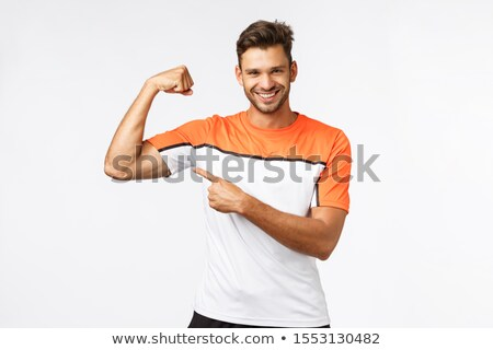 Guy brag with muscles asking if you want touch or gain such good body shape yourself. Sassy smiling, Stock photo © benzoix