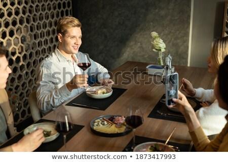 Jonge man glas wijn toast geserveerd Stockfoto © pressmaster