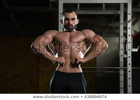 Realizar atrás cuerpo constructor hombre Foto stock © Jasminko