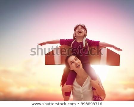 Moeder kind astronaut kostuum spelen samen Stockfoto © choreograph