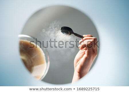 Man Adding Sugar To Coffee Viewed From Inside A Mug Stock photo © diego_cervo