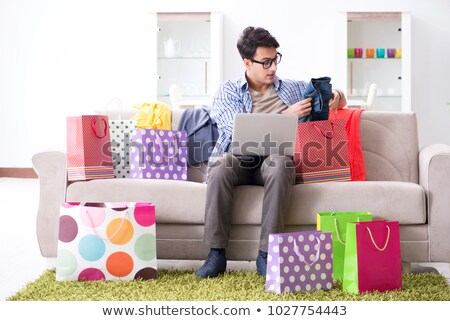 Young man buying clothing online and running blog Stock photo © Elnur