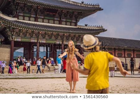 Mom and son tourists in Korea. Gyeongbokgung Palace grounds in Seoul, South Korea. Travel to Korea c Stock photo © galitskaya