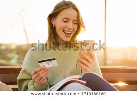 Portré szép izgatott nő tart mobiltelefon Stock fotó © deandrobot