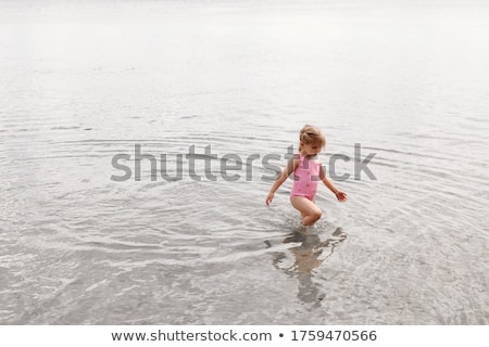 Gyerekek lány lábak tengerparti homok part nyári vakáció Stock fotó © lunamarina