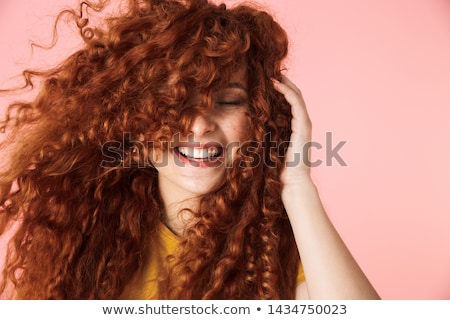 Closeup portrait of pretty young woman with red hairs posing nea Stock photo © HASLOO