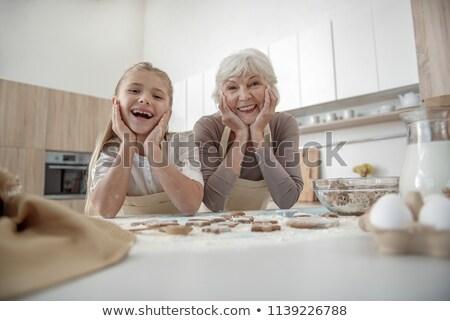 granny in the kitchen having breakfast Stock photo © photography33