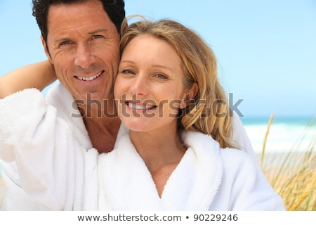 男 女性 着用 ドレッシング ビーチ 幸福 ストックフォト © photography33